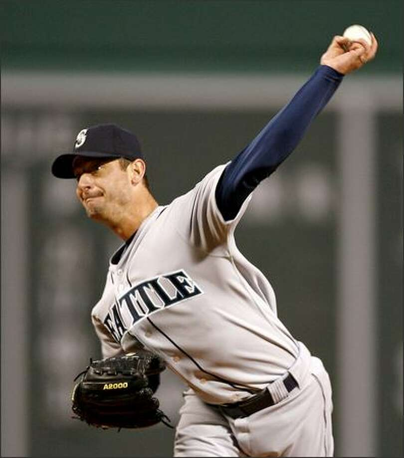 Mariners pitcher Jamie Moyer pitches to Boston's Mark Loretta in the first inning. Moyer went six innings, giving up two runs and eight hits while walking three Red Sox and striking out eight. He took the loss to fall to 0-2 but lowered his ERA to 3.93. View a gallery of game photos. Photo: / Associated Press