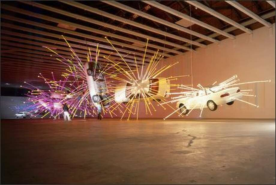 "Nine Ford Tauruses take to the air with flying colors in Cai Guo-Qiang's ""Inopportune: Stage One."" It can be seen when SAM reopens next spring. Photo: /HIRO IHARA"
