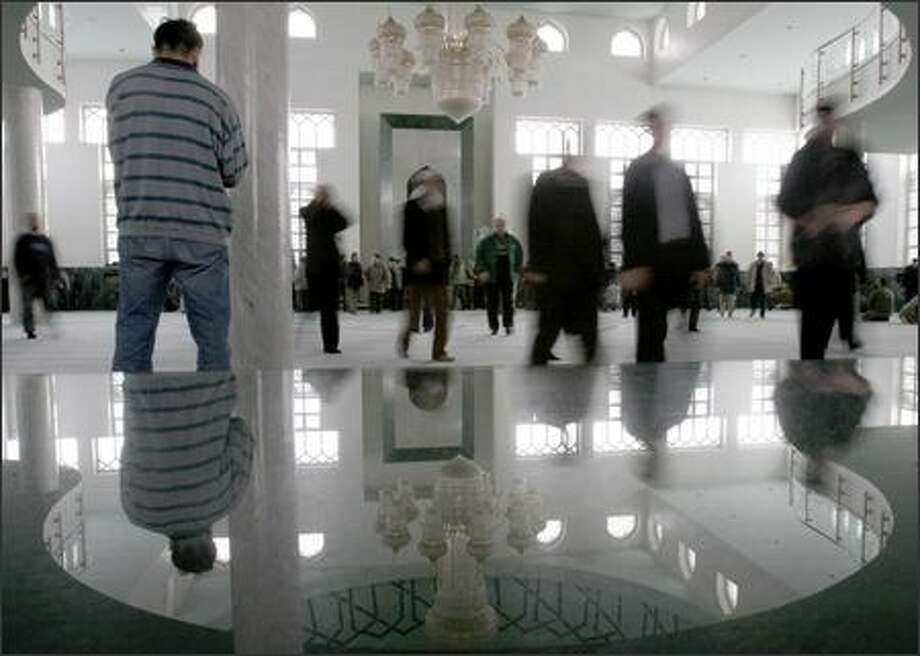 Muslims visit a Sarajevo mosque Monday. Joblessness and insults to Islam could lead young men to join terrorist groups, a report says. Photo: / Associated Press
