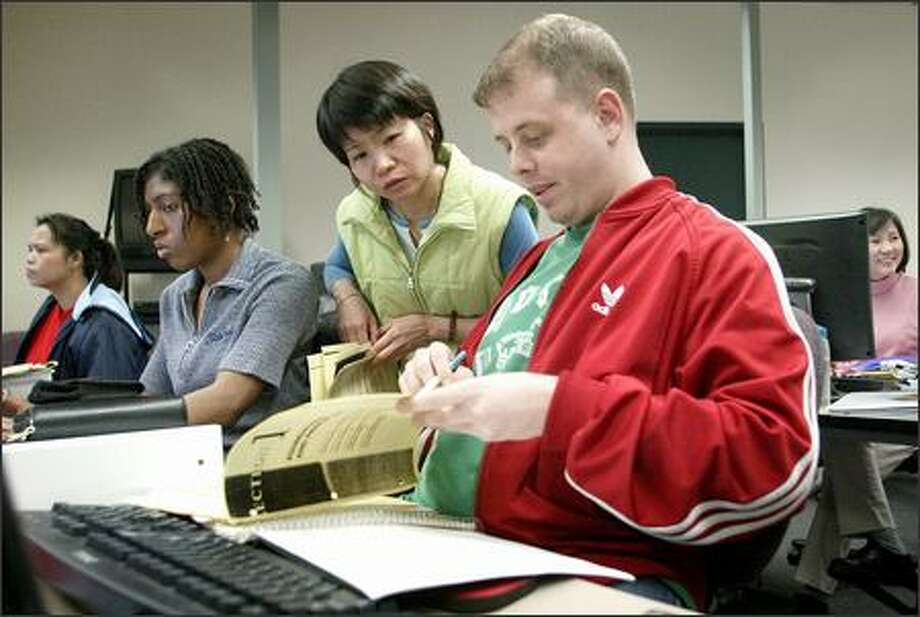 From left, students Nyna Nget, Gigi Walker, Ling Wong and Mick O'Connell study in the medical-office program at South Seattle Community College. Photo: Gilbert W. Arias/Seattle Post-Intelligencer