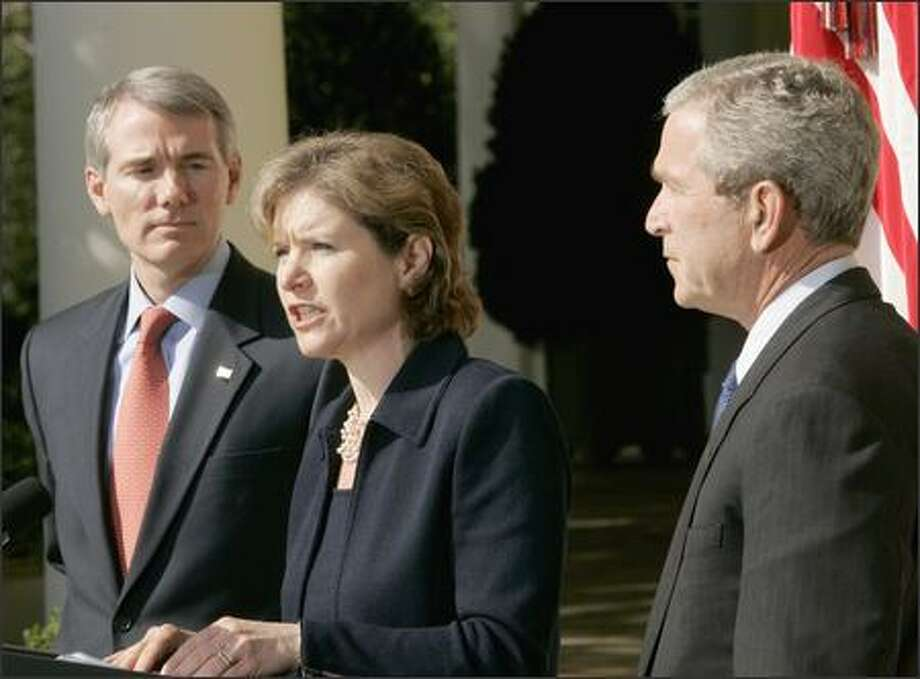 In the White House Rose Garden on Tuesday, President Bush presents Susan Schwab, newly appointed U.S. trade representative, and Rob Portman, who was nominated as director of the Office of Management and Budget. Photo: / Associated Press