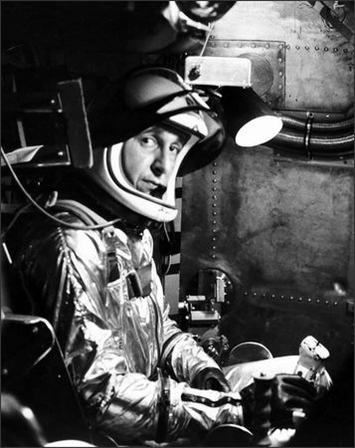 Test Pilot Scott Crossfield sits in a centrifuge machine which duplicates the stress of extreme acceleration encountered by jet pilots at high altitudes in this Feb. 28, 1958, file photo. Crossfield, the first person to fly at twice the speed of sound, was found dead Thursday in the wreckage of a single-engine plane in the mountains of northern Georgia.