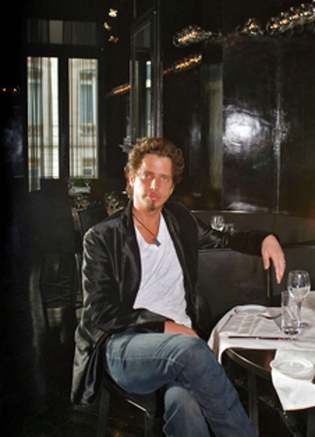 Chris Cornell (sitting in his new restaurant) remembers his early days as a starving musician when his job as a cook had its benefits.