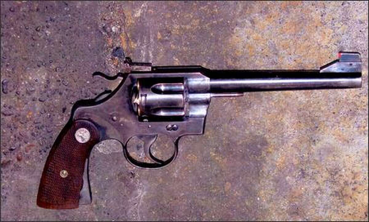 This photo, provided by the Seattle Police Department, shows the damaged cartridge in the cylinder of the gunman's revolver.