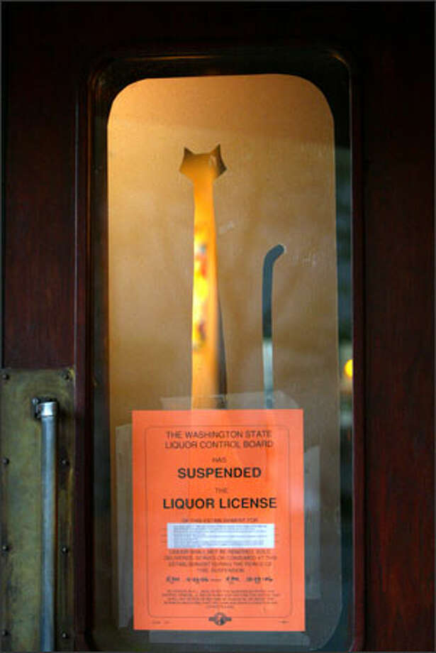 A suspended liquor license notice posted Wednesday on the front door of the Mr. Lucky nightclub, which is across the street from the main First Avenue North entrance to KeyArena. Photo: Grant M. Haller/Seattle Post-Intelligencer