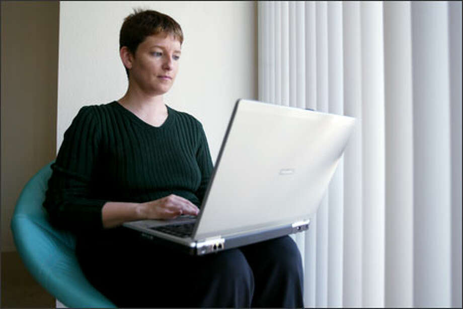 Laurell Haapanen, a technical editor, is bombarded by phishing scams at work every day. But she fell victim to one on her home computer. Photo: Paul Joseph Brown/Seattle Post-Intelligencer