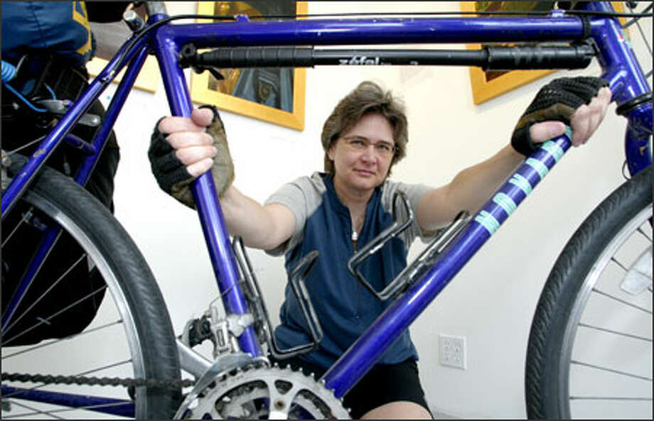 CJ Ritchie, shown in Ballard Sunday, plans to ride her 15-year-old bicycle 1,600 miles around the hurricane-devastated Gulf Coast. Photo: Gilbert W. Arias/Seattle Post-Intelligencer / Seattle P-I
