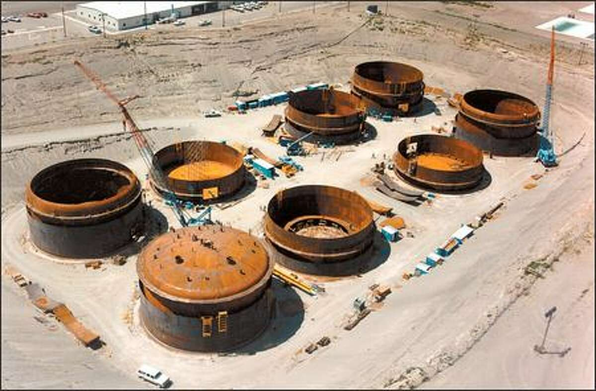 These double-walled tanks at Hanford each hold 1 million gallons of highly radioactive nuclear waste from bomb making. Built in 1984, they were later covered with 5 feet of dirt. The liquid waste that's inside them is slated to be pumped out and turned into glass.