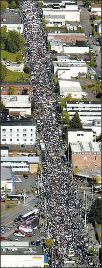 Thousands march down Jackson Street in Seattle in support of immigrant rights. One organizer said Monday's event drew 30,000. Photo Gallery: Scenes from the rally Photo: Mike Urban/Seattle Post-Intelligencer