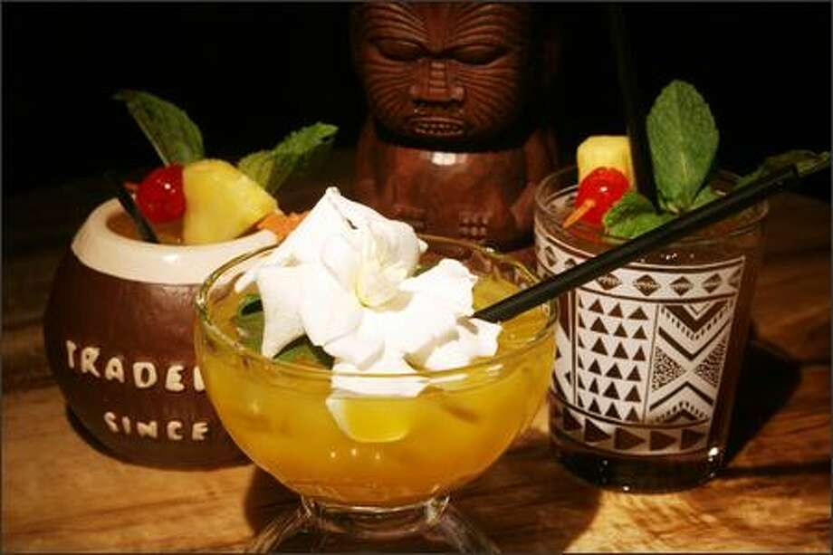 Drinks Trader Vic's is known for include, from left, Tabu (a signature drink of the old Seattle Vic's), Scorpion, Mai Tai. Photo: Meryl Schenker/Seattle Post-Intelligencer