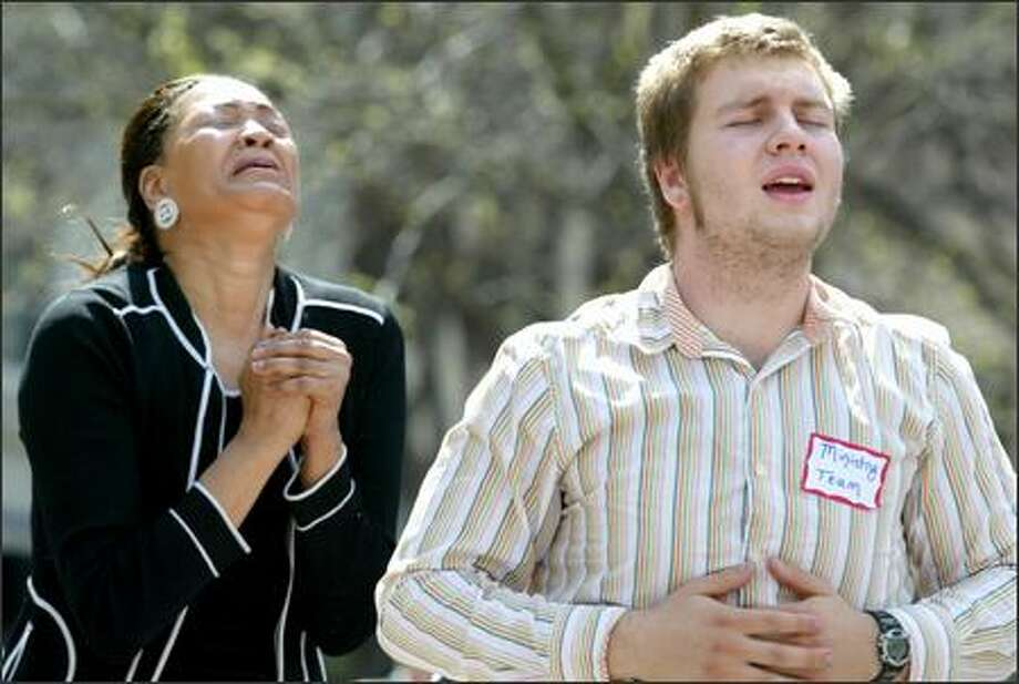 Cheri Dawson and Adam Schoeneberg participate with about 200 others in the National Day of Prayer gathering Thursday at Westlake Park in Seattle. Photo: Paul Joseph Brown/Seattle Post-Intelligencer