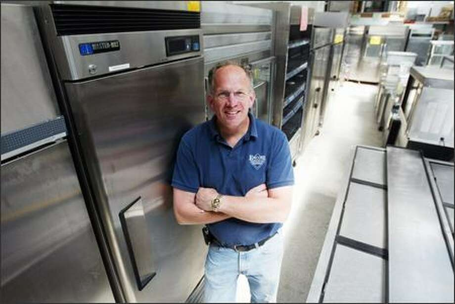 Tim Gilday is the owner of Encore Restaurant Equipment in Seattle, a store that has seen a surge of home chefs recently. Photo: Paul Joseph Brown/Seattle Post-Intelligencer