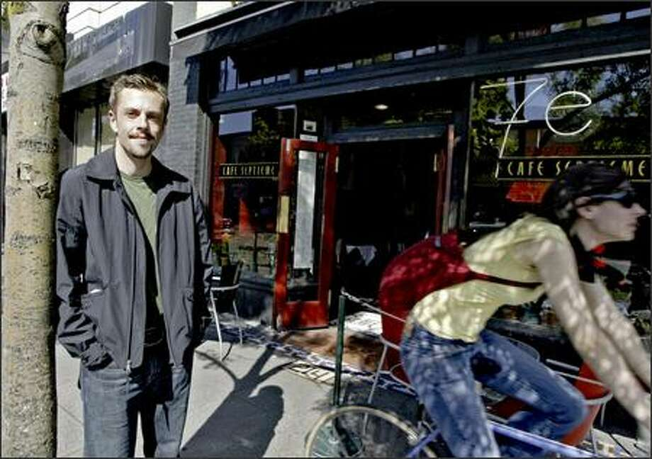 Vance Wolfe stands outside his former workplace, Cafe Septieme, on Friday. Photo: Jim Bryant/Seattle Post-Intelligencer