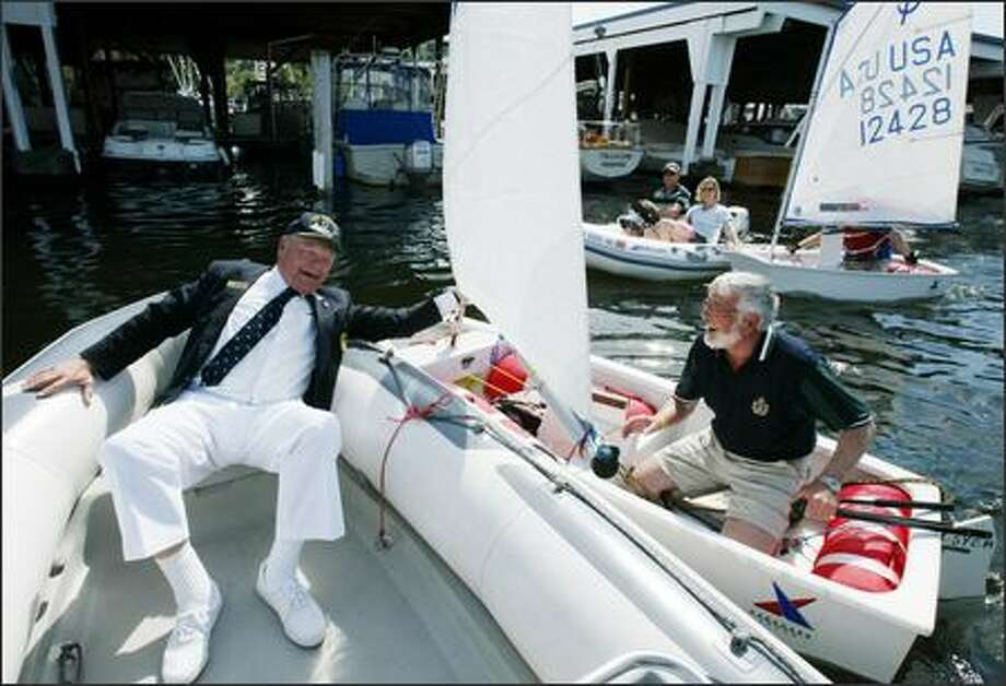 Jack Sullivan, left, Rear Commodore of the Seattle Yacht Club, tries to stop David Jennings, the Commodore of the Royal Vancouver Yacht Club from winning the annual Commode Cup Race during pre-opening day festivities on May 5, 2006 at the Seattle Yacht Club. Jennings won anyway in the race where cheating is encouraged. Photo: Meryl Schenker/Seattle Post-Intelligencer