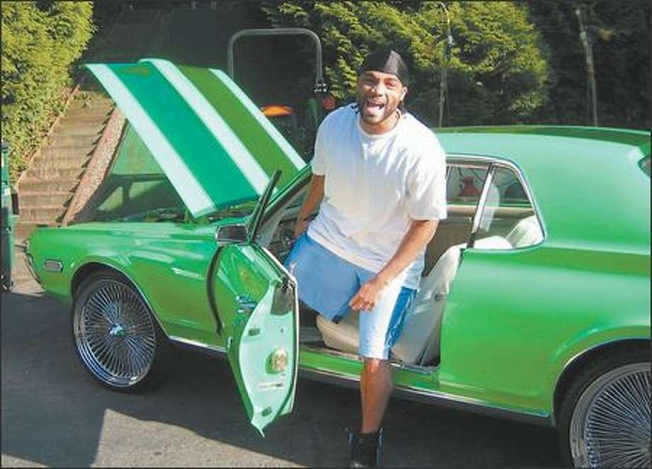 How do you roll if you're a Seattle Seahawks backup quarterback? If you're Seneca Wallace, you roll in a 1968 Mercury Cougar painted a fluorescent green so shocking all heads turn whenever you drive by. The $15,000 paint job was a Super Bowl gift to himself. Photo: SEATTLE SEAHAWKS