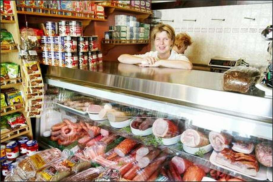 Owner Janet Lidzbarski also works behind the meat counter at George's Sausage and Delicatessen. Photo: Scott Eklund/Seattle Post-Intelligencer