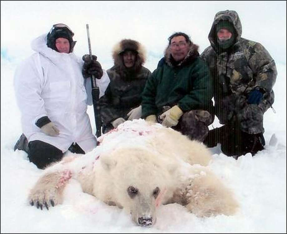Jim Martell, left, shows a hybrid bear he shot on Banks Island in Canada. Hunting guide Roger Kuptana is second right. Photo: / Associated Press