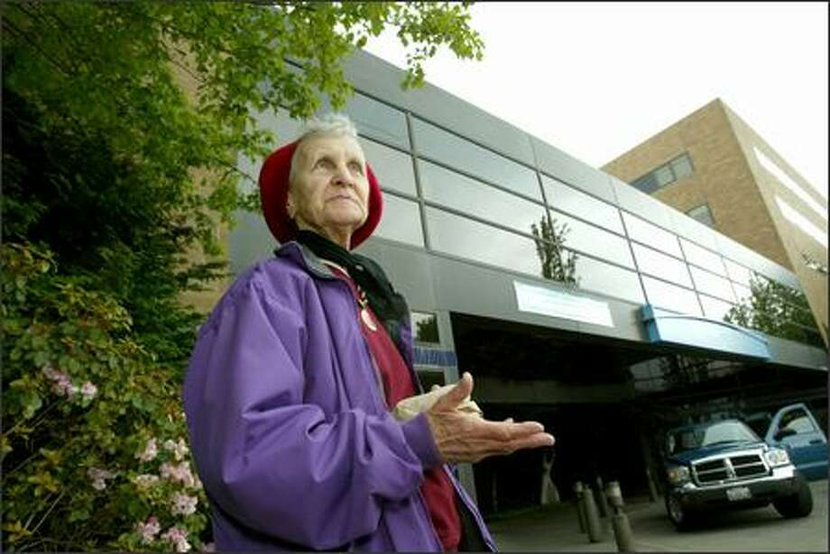 Standing in front of the main entrance, Rita Bohon, 75, talks about the history of the hospital that became Swedish Medical Center/Ballard. She grew up across the street and has been a patient in the hospital. Photo: Grant M. Haller/Seattle Post-Intelligencer