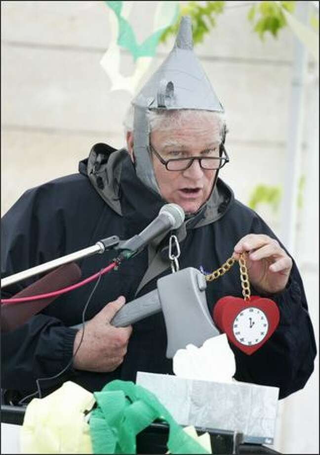 """""""Tin Man"""" Richard Littleton says at the Sonics protest Thursday he is giving his heart back to the city so it can address compassionate causes. Photo: Meryl Schenker/Seattle Post-Intelligencer"""