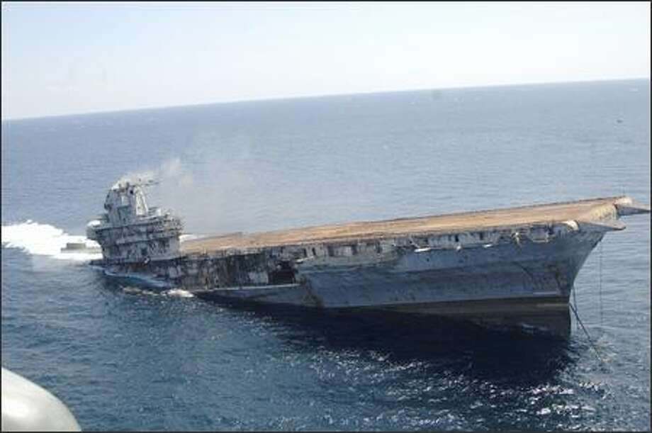 The USS Oriskany sinks Wednesday after the Navy blew up the retired aircraft carrier to create a fishing and diving reef off Florida. Photo: / Associated Press