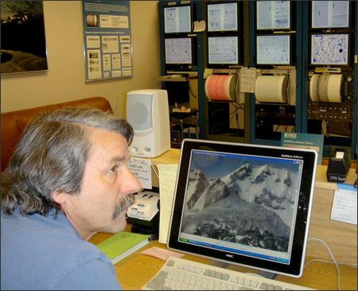 Rick LaHusen, research scientist with the U.S. Geological Survey, looks at a digital image of the dome building on Mount St. Helens.