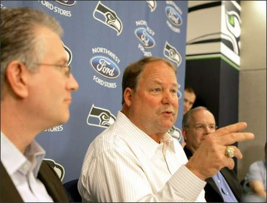 From left, Seahawks CEO Tod Leiweke, coach Mike Holmgren and president Tim Ruskell talk Wednesday about Holmgren's extension. Photo: / Associated Press