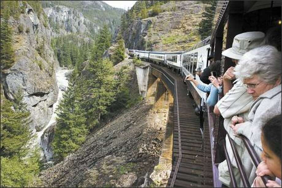 Whistler Mountaineer ascends 2,000 feet as it passes through Cheakamus Canyon. Passengers in the open-air observation car take in spectacular views. Photo: Christopher Grabowski/Special To The Seattle Post-Intelligencer