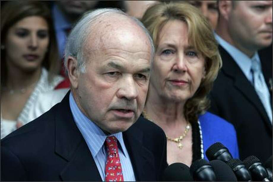 Convicted felon Kenneth Lay, with wife Linda, and Jeffrey Skilling will be forced to forfeit assets, and both face heavy fines. Photo: PAT SULLIVAN/AP
