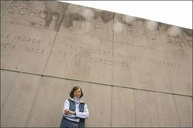 Fifty-five years ago today, Marianne Hanson cut the ribbon on the memorial wall she designed to honor Seattle high school students who died during World War II. Returning Sunday, near right, she found the site in a state of neglect. Photo: Mike Kane/P-I