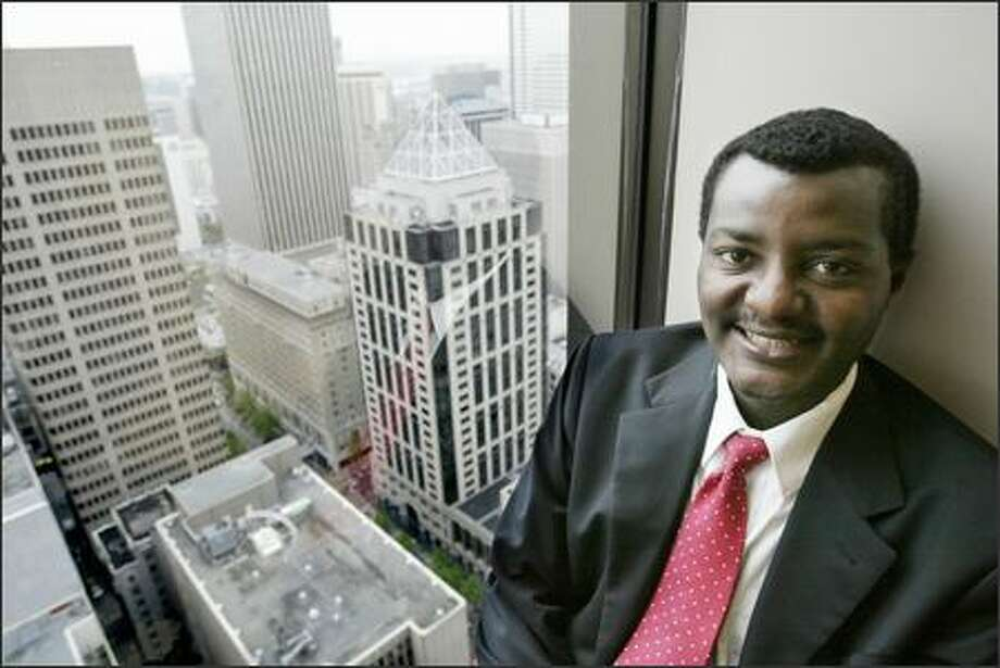 Shakespear Feyissa, an Ethiopian attorney who works downtown, says many local Africans face political wrath in their home countries. Photo: Dan DeLong/Seattle Post-Intelligencer