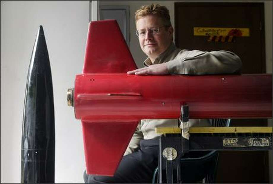 Tom Gonser, co-founder of ZG Aerospace, shows one of the company's test vehicles, an amateur class high-powered rocket, at his Bellevue home. Photo: Dan DeLong/Seattle Post-Intelligencer