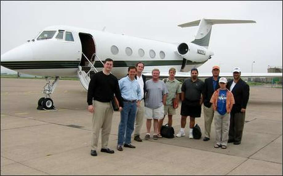 A photo that was provided as an exhibit in the trial of David Safavian shows, from left, Neil Volz, Ralph Reed, Paul Vinovich, Rep. Bob Ney, R-Ohio, Will Heaton, David Safavian, Mike Williams, Alex Abramoff and Jack Abramoff in front of the chartered plane that took the group to St. Andrews, Scotland, in August 2002. Photo: / Associated Press