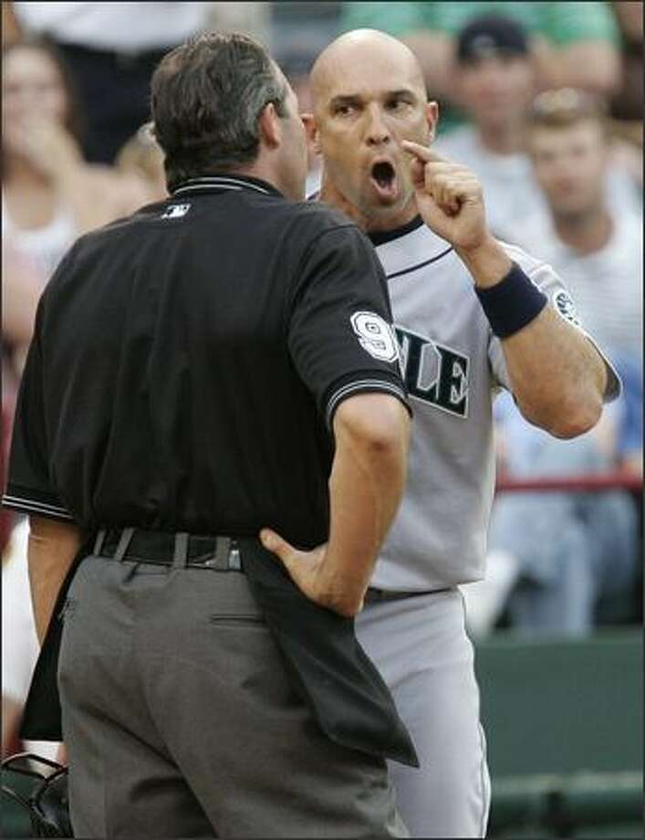 Raul Ibanez heatedly argues a point with umpire Paul Nauert in the first. Ibanez was ejected for disputing a called third strike. Photo: TIM SHARP/AP