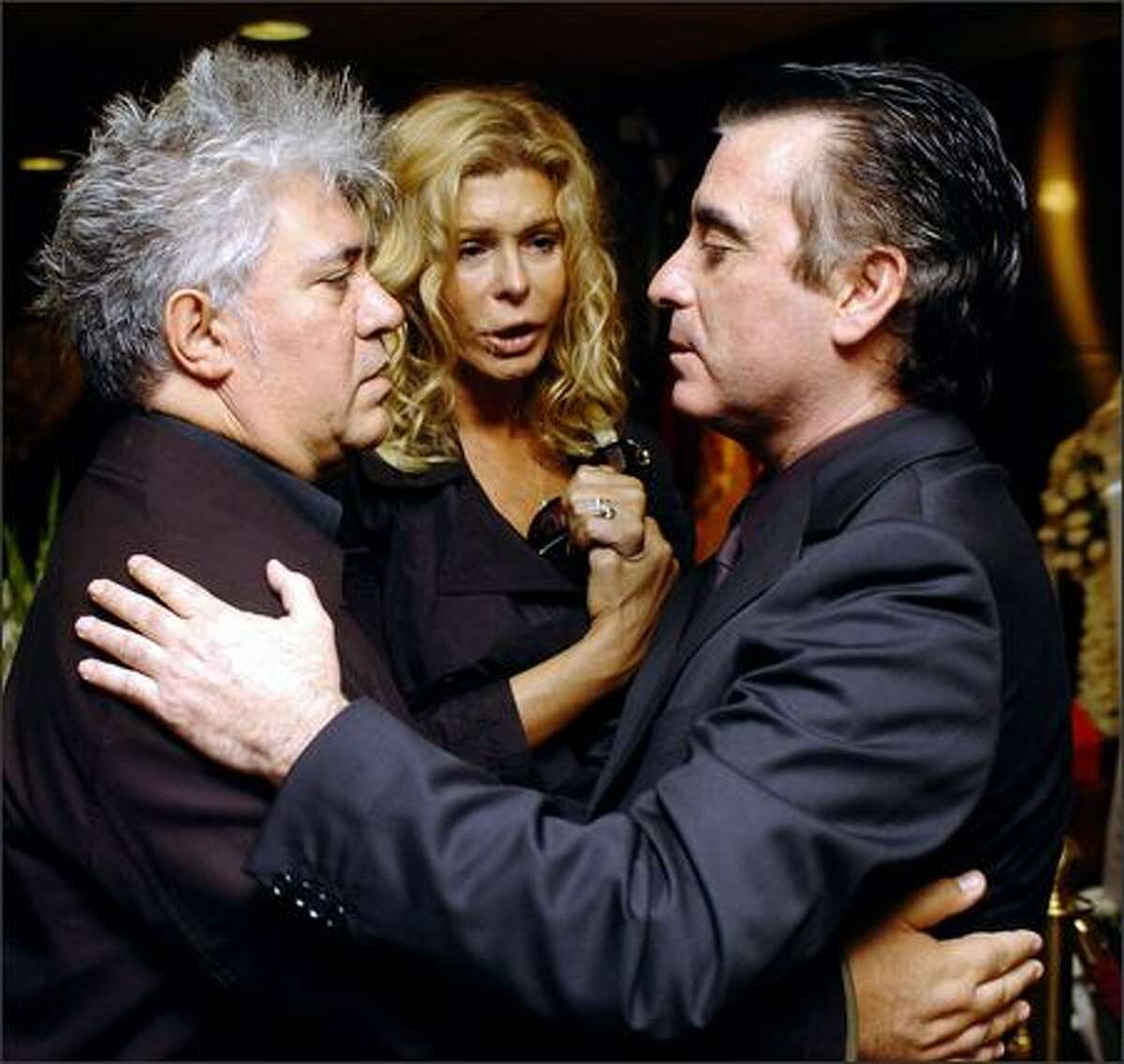 Spanish guys know how to hold each other and make it matter. Director Pedro Almodovar greets bullfighter Jose Ortega Cano, right, widower of actress Rocio Jurado, during a wake in Madrid Thursday. Beloved in Spain and Latin America, Jurado died Thursday of pancreatic cancer. She was 61.
