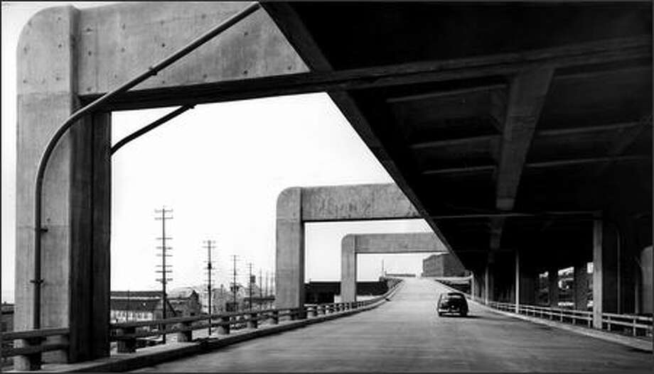 "The 53-year-old Alaskan Way Viaduct ""helped make Seattle,"" preservationist Art Skolnik says. This view, from March 4, 1952, shows the southbound lower deck near Lenora Street. Photo: / Seattle Post-Intelligencer"