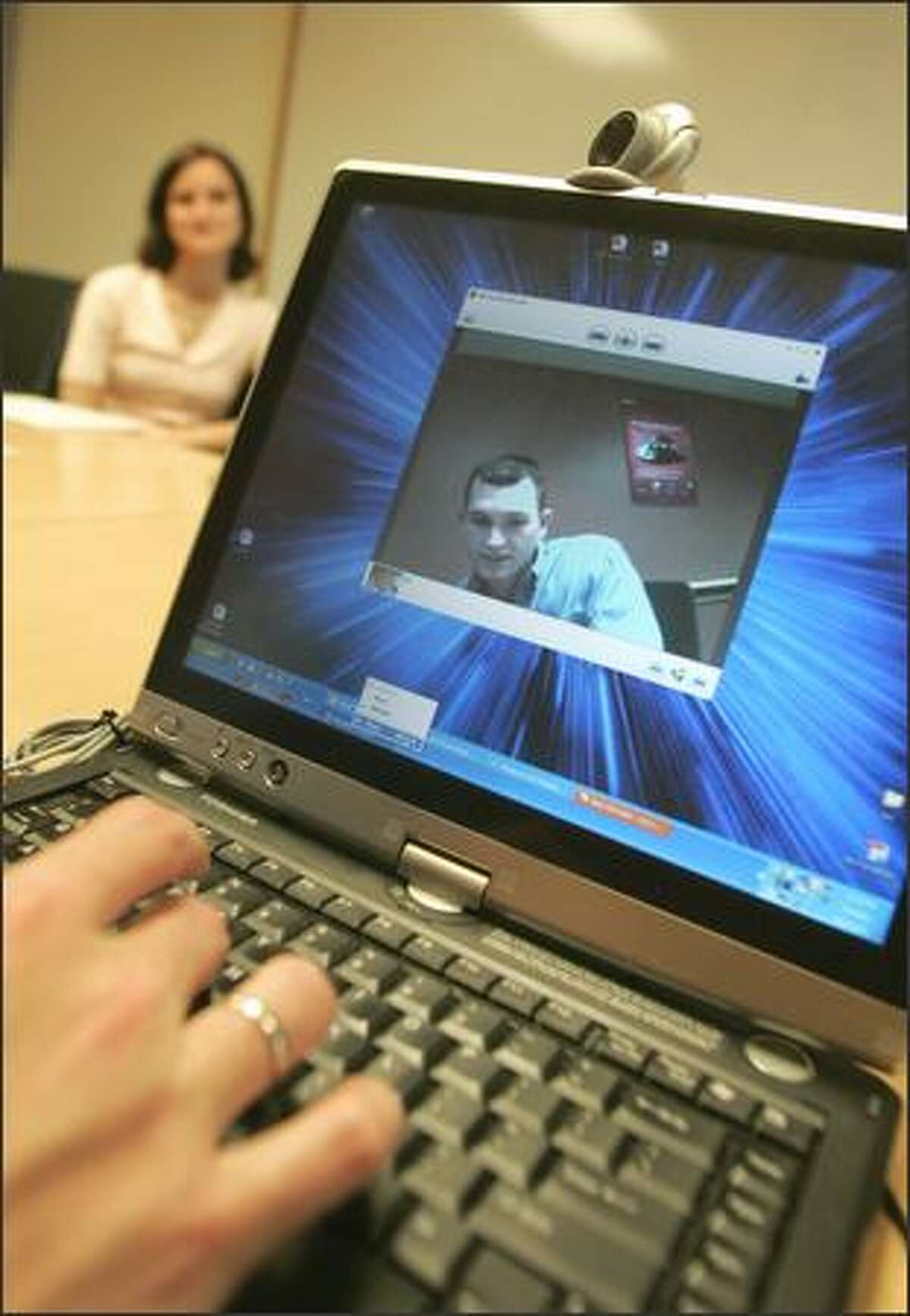 Michael Cowan, product marketing manager for Microsoft Hardware, demonstrates a Webcam the company is creating.