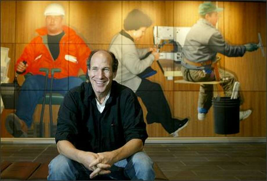 Artist Michael Fajans sits in front of part of his mural in the Seattle federal courthouse in this file photo from 2004. He painted real people and their professions. Photo: Meryl Schenker/Seattle Post-Intelligencer