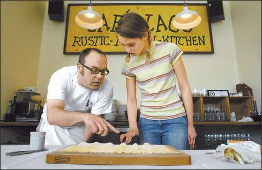Cafe Lago chef Brad Jencks imparts the finer points of making ravioli to Montlake Elementary student Augusta Chapman as part of the Ravioli Project. Photo: Gilbert W. Arias/Seattle Post-Intelligencer