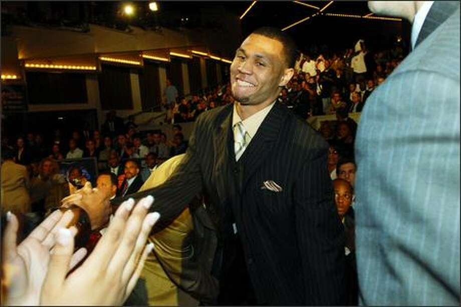 Brandon Roy is all smiles after being selected with the No. 6 pick by the Minnesota Timberwolves. He was later traded to Portland. Photo: Angela Jimenez/Special To The P-I