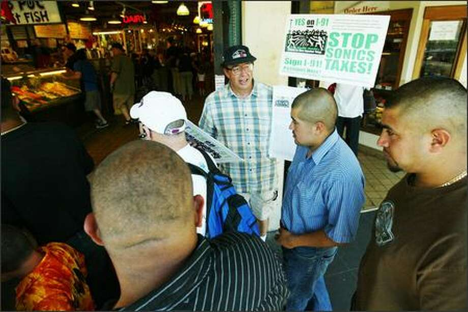 Chris Van Dyk, leader of Citizens for More Important Things, campaigns at Pike Place Market against the Sonics' bid for a tax-subsidized KeyArena overhaul. Photo: Paul Joseph Brown/Seattle Post-Intelligencer