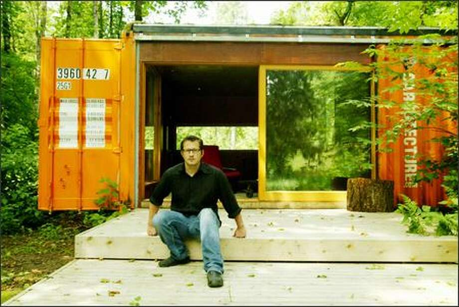 (Editor's Note: This caption has been altered. Joel Egan, one of the partners in Studio 320, which advocates using cargo containers for housing, is a designer. His profession was misstated in the original version of this caption.)  Designer Joel Egan, above, and architect Robert Humble designed this cabin in Enumclaw using shipping containers. Cargo containers are cheap, plentiful, strong and durable. Photo: Paul Joseph Brown/Seattle Post-Intelligencer