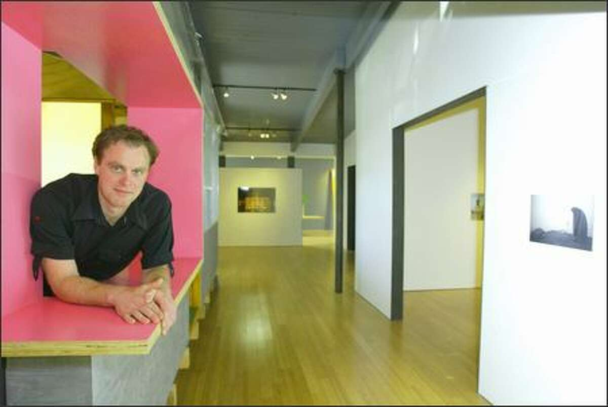 Scott Lawrimore looks out from the office of his new gallery, which is a sweeping space with quirky touches.