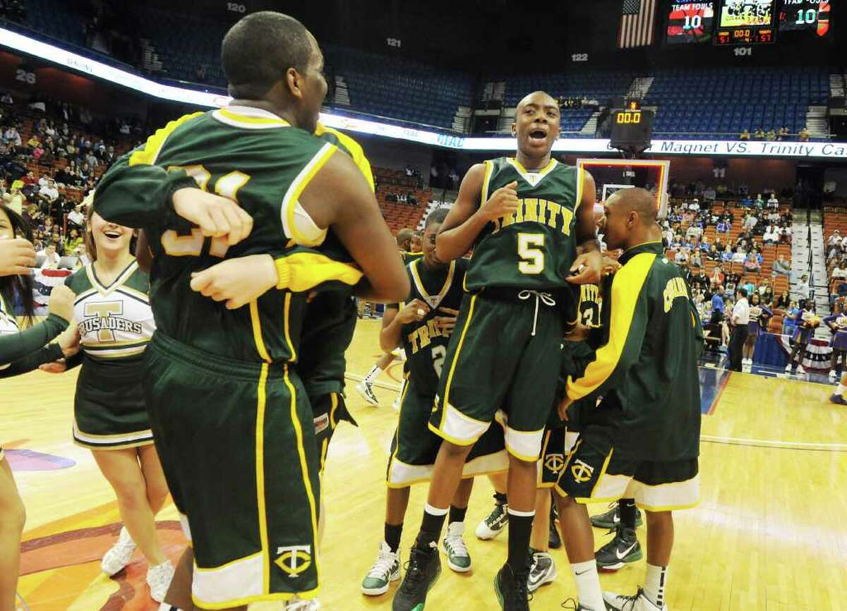 Trinity Catholic's Brandon Wheeler celebrates their 57-51 win over Career Magnet in the Class M boys basketball state championship game at Mohegan Sun Arena in Uncasville, Conn., March 19, 2011.