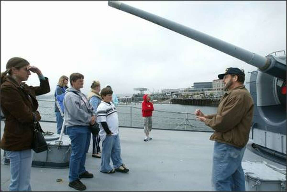 Bill Moore, right, leads a tour of the USS Turner Joy, a destroyer that is a permanent attraction on the Bremerton waterfront.