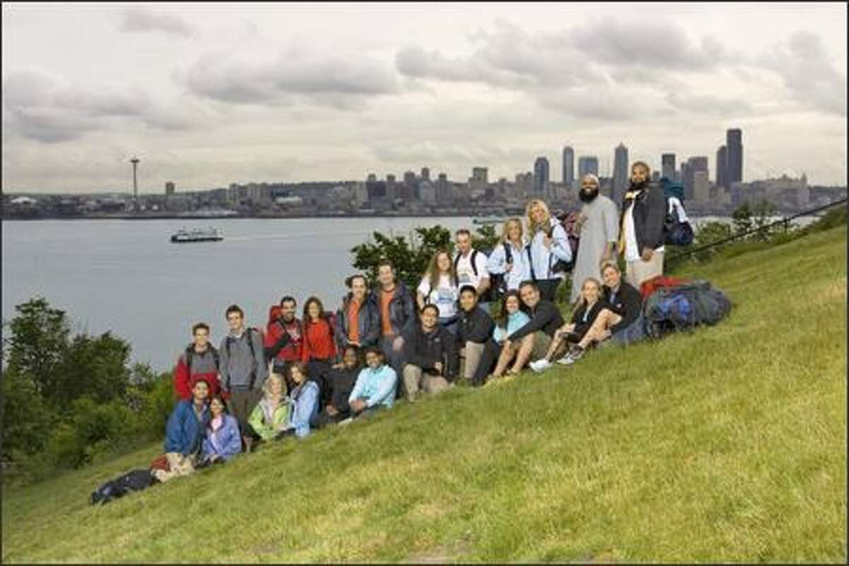 """Seattle was the starting point for the latest season of CBS's """"The Amazing Race."""" Teams include (left to right, front row) Vipul and Arti, Kellie and Jamie, Lyn and Karlyn, Erwin and Godwin, Kimberly and Rob, Sarah and Peter (left to right, back row) Tyler and James, Duke and Lauren, Tom and Terry, Mary and David, Dustin and Kandice and Bilal and Sa'eed."""