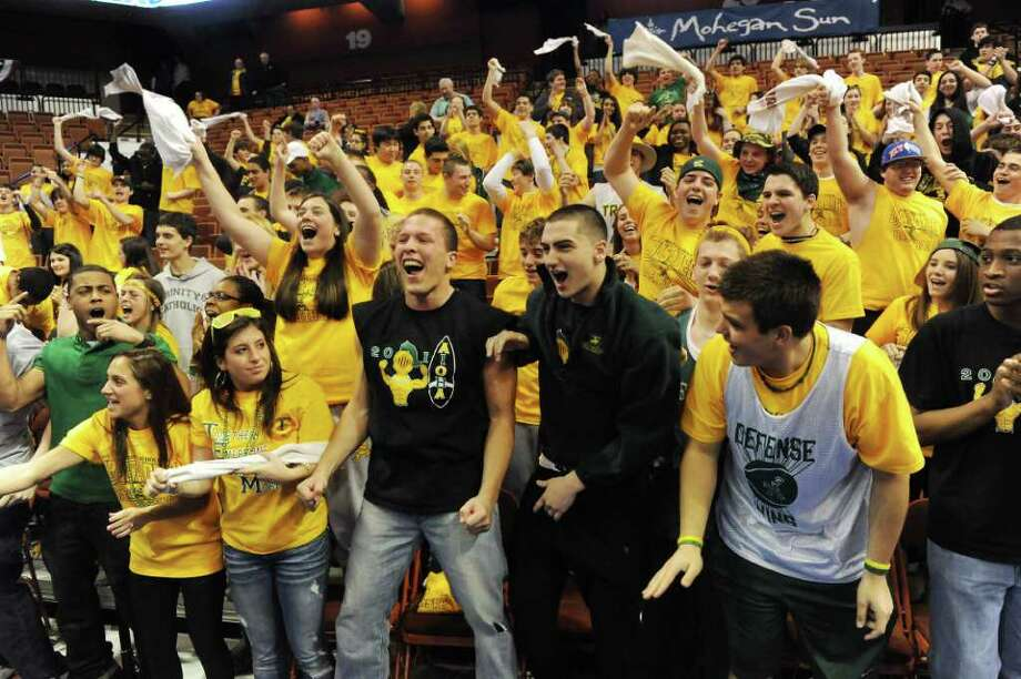 The Trinity Catholic fans cheer on their boys basketball team as they defeat Career Magnet 57-51 in the Class M state championship game at Mohegan Sun Arena in Uncasville, Conn., March 19, 2011. Photo: Kathleen O'Rourke / Stamford Advocate