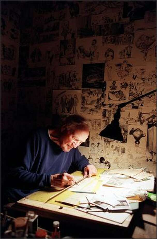 Bob McCausland, who died Friday at age 90, created a collage of his cartoons on the walls of his basement. Photo: / Seattle Post-Intelligencer
