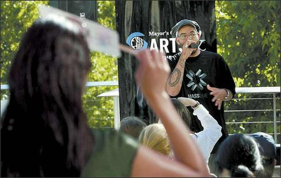 "RA Scion of Common Market reads one of his poems Thursday during ""Traffic Jam,"" Poetry Mash Up at City Hall Plaza. Photo: Grant M. Haller/Seattle Post-Intelligencer"