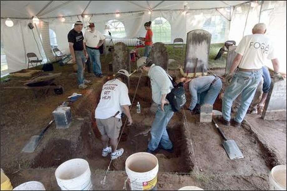 Archaeologists dig at the 200-year-old gravesite of freed slave Venture Smith and his family in East Haddam, Conn. The dig has the blessing of more than a dozen of his descendants. Photo: / Associated Press