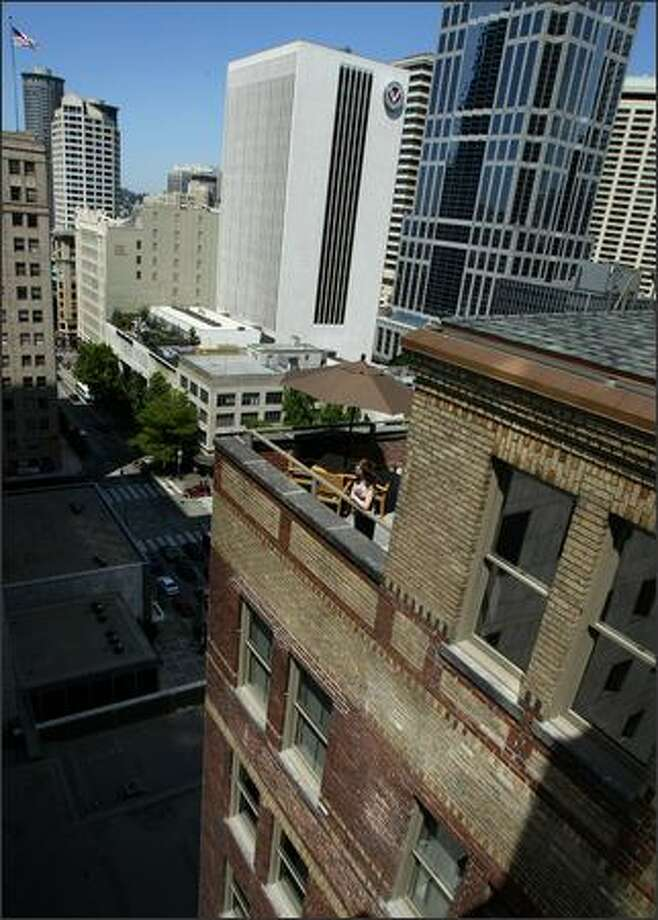 A common area and courtyard can be seen atop The Cobb Building, which was designed as a medical-dental facility and was completed in 1910. Among its apartments are two penthouses. Photo: Joshua Trujillo/Seattle Post-Intelligencer